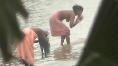 Indian women bathing by the river