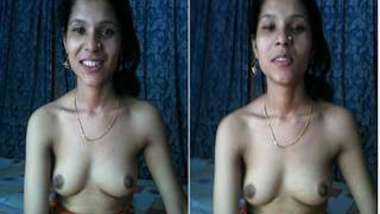 Sexy female sets camera on and poses with naked XXX boobs for Desi men
