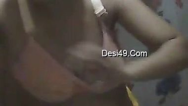Attractive Desi girl changes in bathroom without knowing about cam
